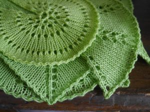 Pile of Shawl Swatches in Green from Holly Chayes' Shawl Geometry Series