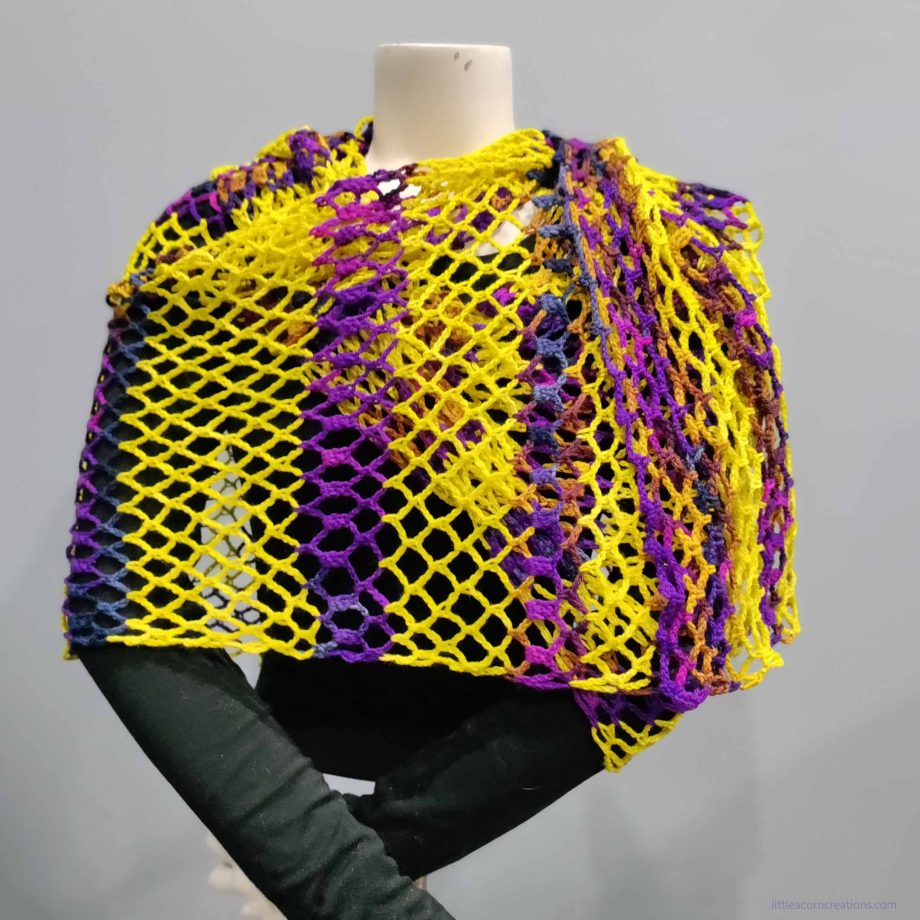 Northern Lights Wrap shown on a mannequin, front view showing side stripe sequence