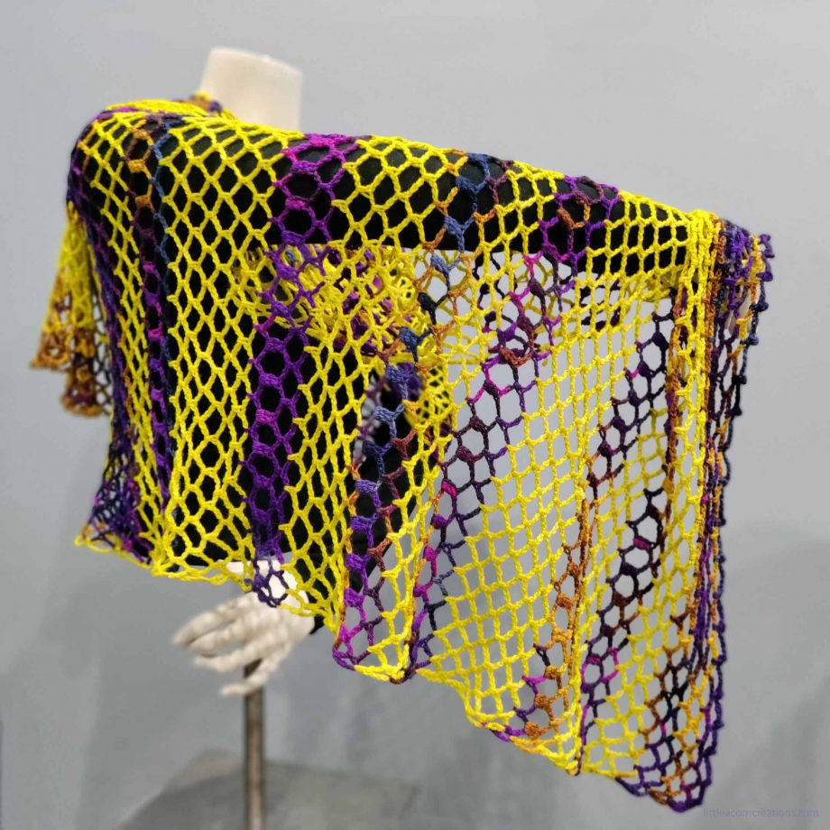 Northern Lights Wrap shown on a mannequin, with arm lifted to show off drape