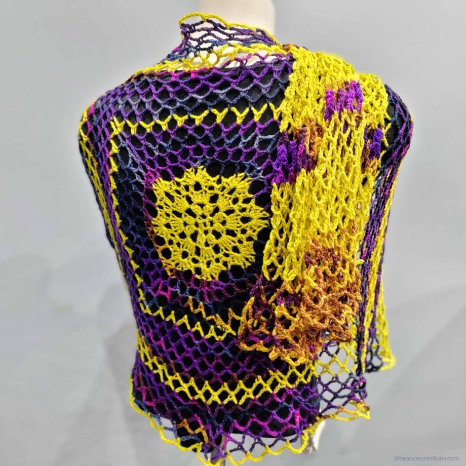 Northern Lights Wrap shown on a mannequin, one side is tossed over the shoulder