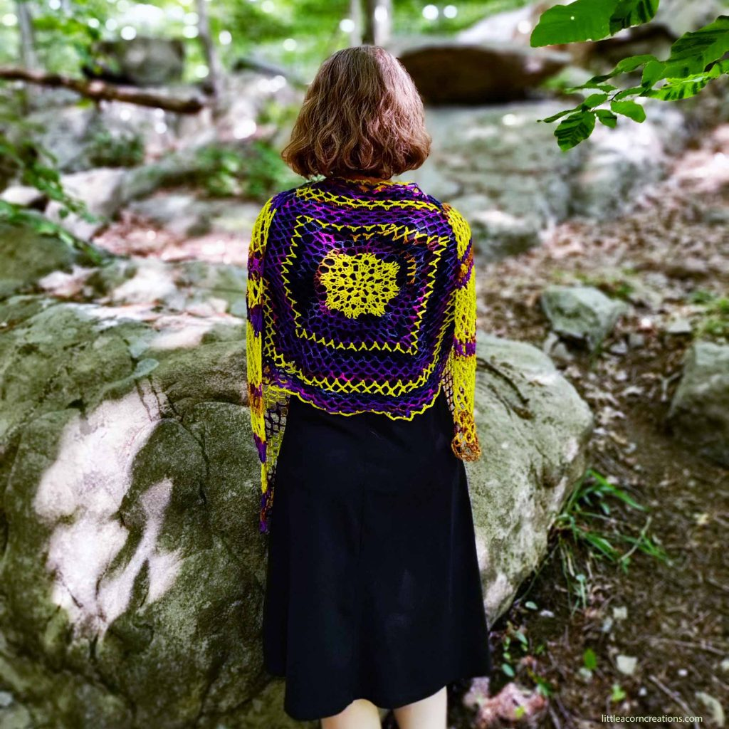 """Northern Lights Crochet Wrap, motif detail, shown on 5'2"""" model in an outdoor setting."""