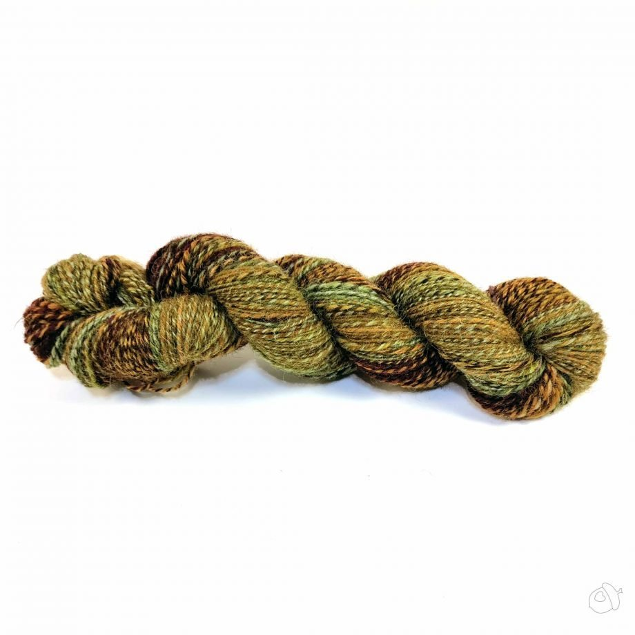 3 ply handspun yarn in colors evocative of autumn leaves: maroons, golds, and greens