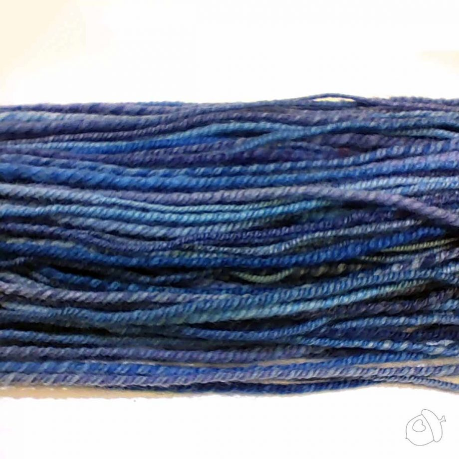 closeup of variegated blue handspun superfine merino, chain ply