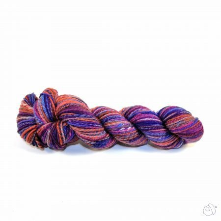 handspun yarn in colors evocative of a summer sunset, reds, oranges, purples, and deep blues